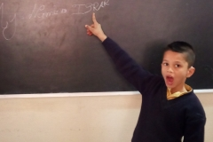Hearing Impaired child writing his name
