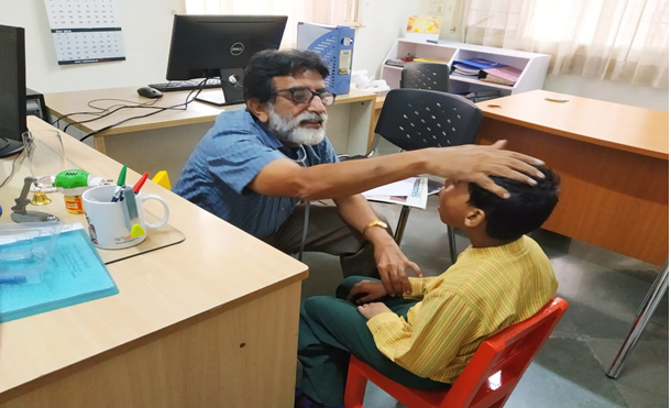 "H.I Children were examined by our trustee ""Dr. Ram Gandhi"""